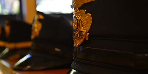 UPD images of police hats lined up in a row